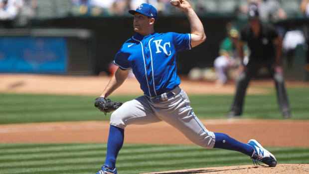 Jun 13, 2021; Oakland, California, USA; Kansas City Royals starting pitcher Kris Bubic (50) pitches during the first inning against the Oakland Athletics at RingCentral Coliseum. Mandatory Credit: Stan Szeto-USA TODAY Sports