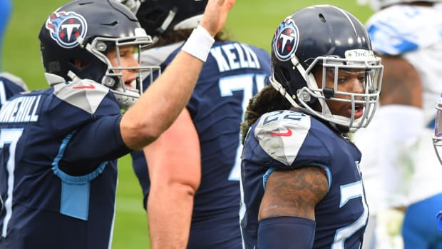 Tennessee Titans running back Derrick Henry (22) celebrates with quarterback Ryan Tannehill (17) after a touchdown during the first half against the Detroit Lions at Nissan Stadium.