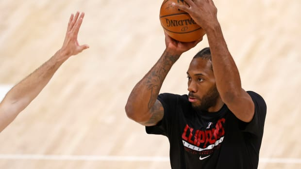 Jun 8, 2021; Salt Lake City, Utah, USA; LA Clippers forward Kawhi Leonard (2) warms up prior to game one in the second round of the 2021 NBA Playoffs. at Vivint Arena. Mandatory Credit: Jeffrey Swinger-USA TODAY Sports