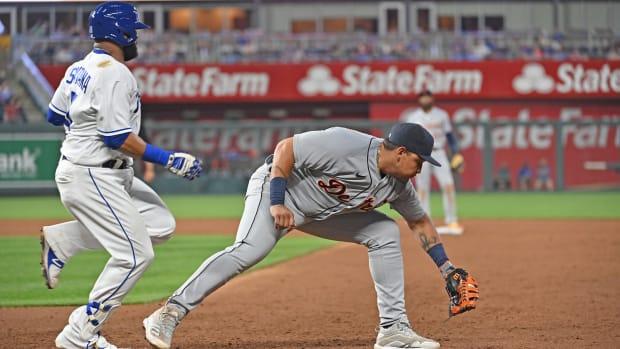 Jun 14, 2021; Kansas City, Missouri, USA; Detroit Tigers first baseman Miguel Cabrera (24) forces out Kansas City Royals first baseman Carlos Santana (41) at first base during the fifth inning at Kauffman Stadium. Mandatory Credit: Peter Aiken-USA TODAY Sports
