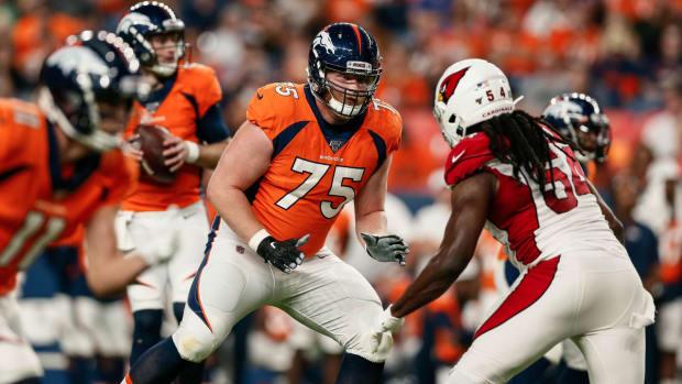 Denver Broncos offensive tackle Quinn Bailey (75) guards Arizona Cardinals linebacker Vontarrius Dora (54) in the second quarter at Broncos Stadium at Mile High.
