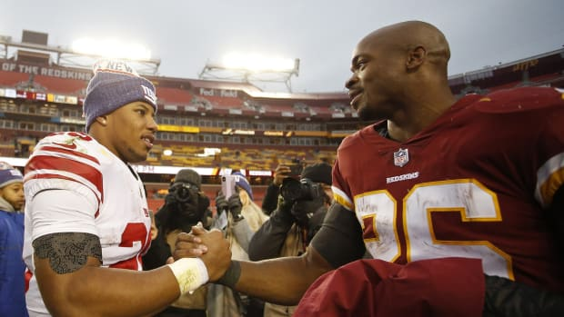 Dec 9, 2018; Landover, MD, USA; New York Giants running back Saquon Barkley (26) shakes hands with Washington Redskins running back Adrian Peterson (26) after their game at FedEx Field. The Giants won 40-16.