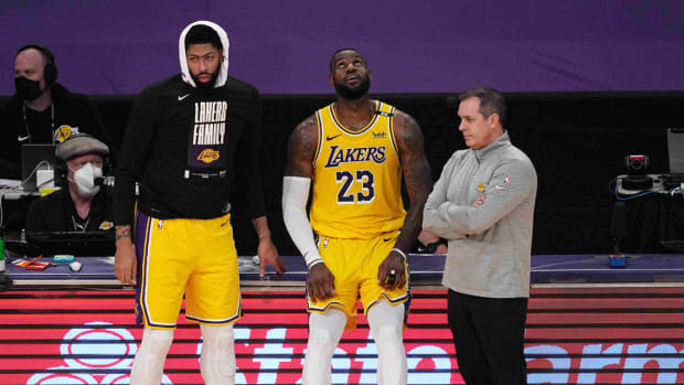 Jun 3, 2021; Los Angeles, California, USA; Los Angeles Lakers forward Anthony Davis (3), forward LeBron James (23) and coach Frank Vogel react in the second half during game six in the first round of the 2021 NBA Playoffs against the Phoenix Suns at Staples Center. Mandatory Credit: Kirby Lee-USA TODAY Sports