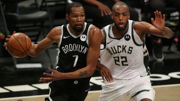 Kevin Durant drives to the hoop against Khris Middleton
