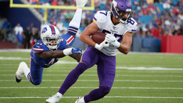 The Buffalo Bills' Maurice Alexander flies through the air as he tries to make the tackle on Vikings tight end Cole Hikutini.