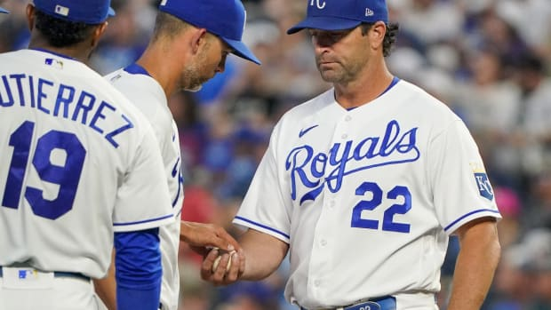 Jun 15, 2021; Kansas City, Missouri, USA; Kansas City Royals manager Mike Matheny (22) comes to the mound as starting pitcher Mike Minor (23) leaves the game in the sixth inning against the Detroit Tigers at Kauffman Stadium. Mandatory Credit: Denny Medley-USA TODAY Sports