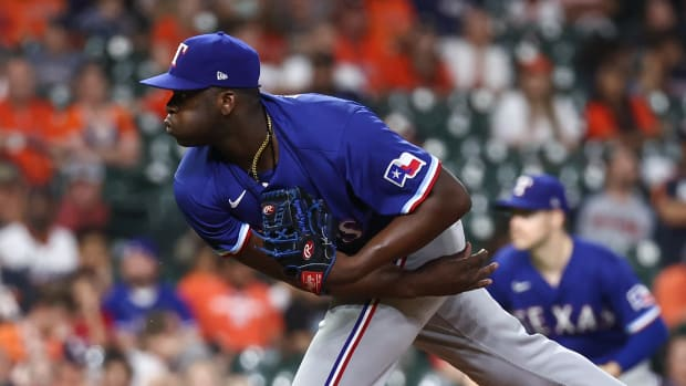 Jun 15, 2021; Houston, Texas, USA; Texas Rangers relief pitcher Demarcus Evans (67) delivers a pitch during the tenth inning against the Houston Astros at Minute Maid Park.