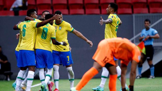 Brazil celebrates against Venezuela.