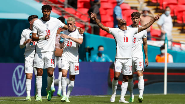 Raheem Sterling scores for England.