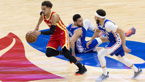 Trae Young dribbles past two defenders in Hawks-Sixers Game 5