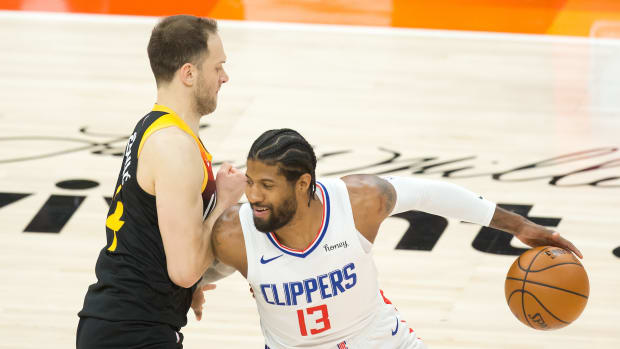 Jun 16, 2021; Salt Lake City, Utah, USA; LA Clippers guard Paul George (13) dribbles the ball against Utah Jazz forward Bojan Bogdanovic (44) during the first quarter of game five in the second round of the 2021 NBA Playoffs at Vivint Arena. Mandatory Credit: Russell Isabella-USA TODAY Sports