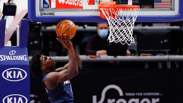 May 11, 2021; Detroit, Michigan, USA; Minnesota Timberwolves forward Anthony Edwards (1) shoots in the first half against the Detroit Pistons at Little Caesars Arena.
