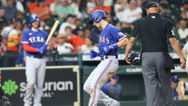 Jun 16, 2021; Houston, Texas, USA;Texas Rangers shortstop Eli White (41) rounds the bases after hitting a home run against the Houston Astros in the seventh inning at Minute Maid Park.