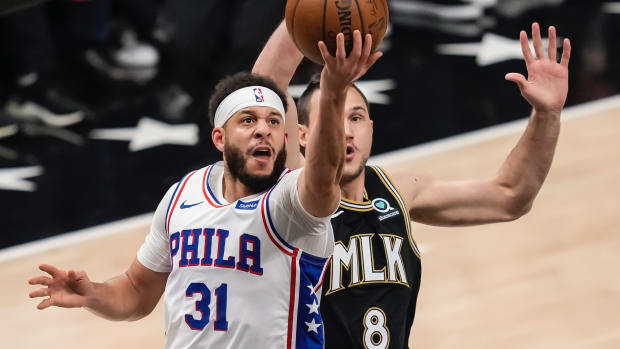 Philadelphia 76ers guard Seth Curry (31) drives to the basket against Atlanta Hawks forward Danilo Gallinari (8) during the first quarter in game six in the second round of the 2021 NBA Playoffs