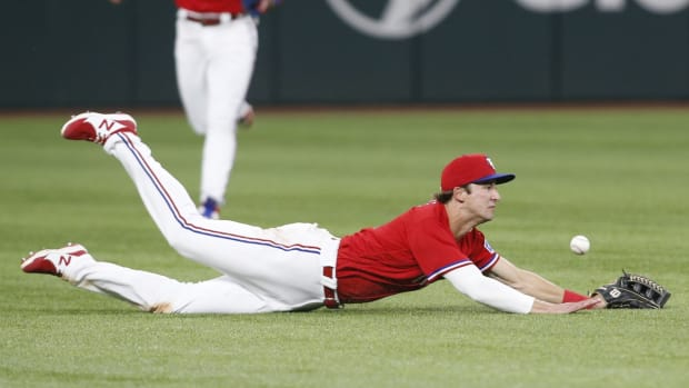Jun 18, 2021; Arlington, Texas, USA; Texas Rangers left fielder Eli White (41) cannot catch a ball hit by Minnesota Twins catcher Ryan Jeffers (not pictured) in the ninth inning at Globe Life Field.