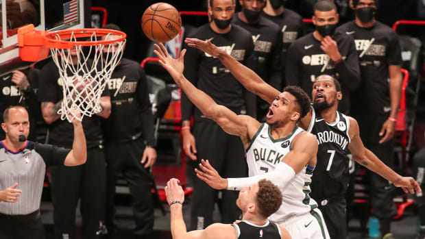 Giannis Antetokounmpo attempting a layup against the Nets