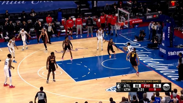 Screenshot of Ben Simmons underneath an unguarded basket
