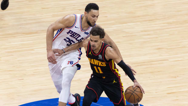 Ben Simmons guards Trae Young