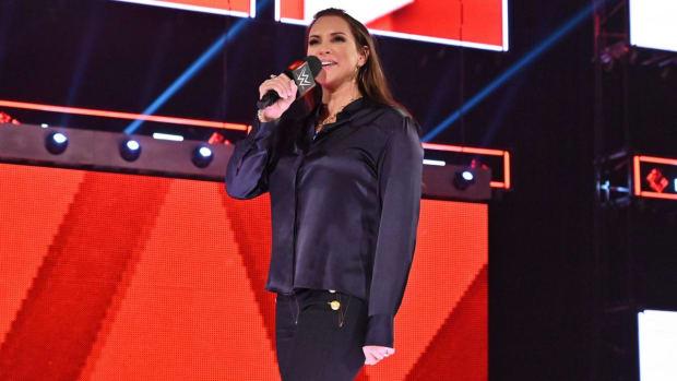 WWE's Stephanie McMahon holding a microphone