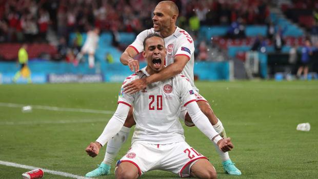 Denmark celebrates a goal against Russia.