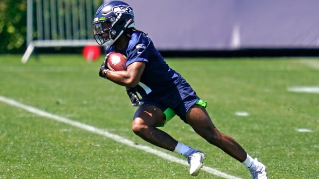 Seattle Seahawks wide receiver D'Wayne Eskridge runs a drill during an NFL football rookie minicamp Friday, May 14, 2021, at the team's training facility in Renton, Wash.