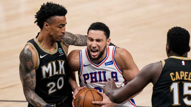 Jun 18, 2021; Atlanta, Georgia, USA; Philadelphia 76ers guard Ben Simmons (25) drives to the basket against Atlanta Hawks forward John Collins (20) during the first half in game six in the second round of the 2021 NBA Playoffs. at State Farm Arena.