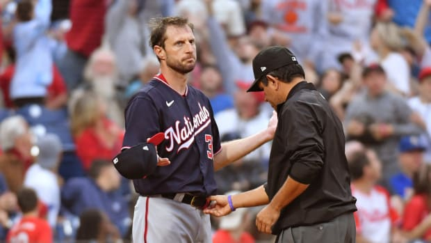 Jun 22, 2021; Philadelphia, Pennsylvania, USA; Washington Nationals pitcher Max Scherzer (31) has his belt checked after he pitched the first inning against the Philadelphia Phillies at Citizens Bank Park.