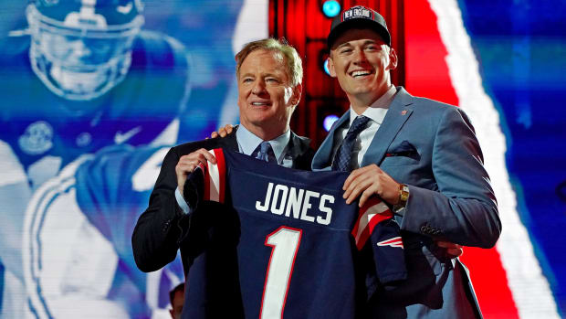 Mac Jones (Alabama) with NFL commissioner Roger Goodell after being selected by the New England Patriots as the number 15 overall pick in the first round of the 2021 NFL Draft at First Energy Stadium.