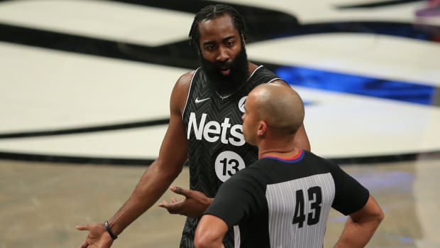 James Harden talking with a referee.