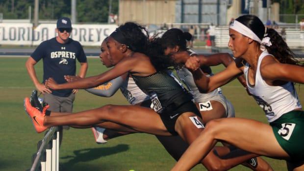 Rayniah Jones Running the Hurdles