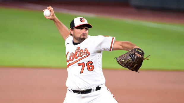 Orioles' Mickey Jannis delivers a pitch