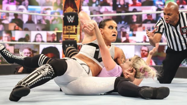 Shayna Baszler puts Alexa Bliss in a submission hold