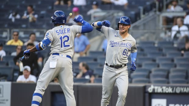 Jun 23, 2021; Bronx, New York, USA; Kansas City Royals designated hitter Ryan O Hearn (66) is greeted by right fielder Jorge Soler (12) after hitting a two-run home run in the first inning against the New York Yankees at Yankee Stadium. Mandatory Credit: Wendell Cruz-USA TODAY Sports