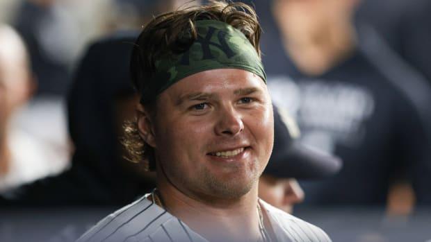 Yankees 1B Luke Voit smiling in dugout