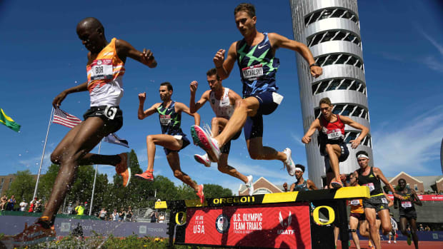A general overall view as Hillary Bor, Daniel Michalski, Isaac Updike and Mason Ferlic race over the water jump in the steeplechase during the US Olympic Team Trials at Hayward Field.