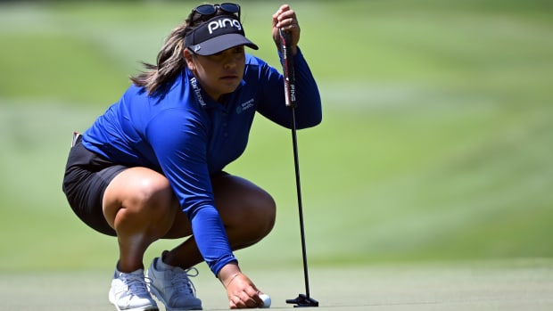 Lizette Salas lines up a putt on the third green during the third round of the KPMG Women's PGA Championship golf tournament at the Atlanta Athletic Club.
