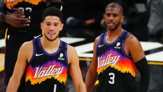 Phoenix Suns guard Chris Paul (3) and Devin Booker (1) against the Denver Nuggets during game two in the second round of the 2021 NBA Playoffs