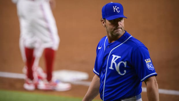Jun 26, 2021; Arlington, Texas, USA; Kansas City Royals manager Mike Matheny (22) walks off the field during the second inning against the Texas Rangers at Globe Life Field. Mandatory Credit: Jerome Miron-USA TODAY Sports