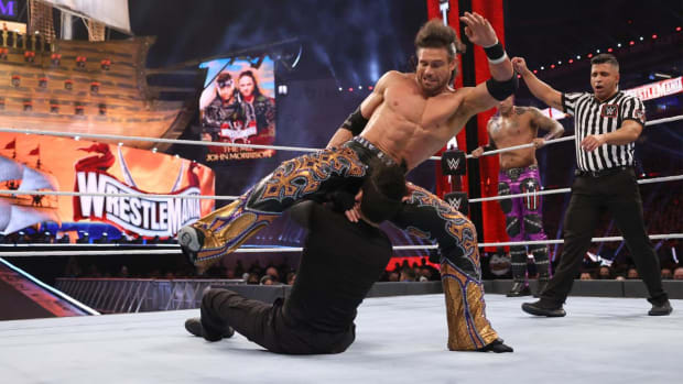 WWE's John Morrison delivers a kick to Bad Bunny
