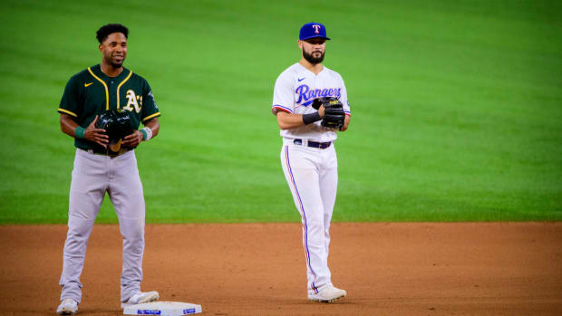 Jun 23, 2021; Arlington, Texas, USA; Oakland Athletics shortstop Elvis Andrus (17) talks with Texas Rangers shortstop Isiah Kiner-Falefa (9) during the seventh inning at Globe Life Field.