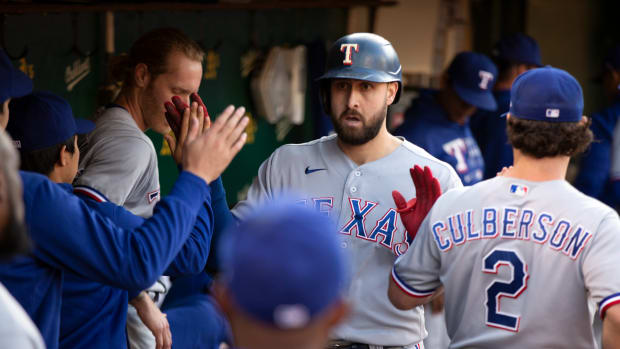 Jun 29, 2021; Oakland, California, USA; Texas Rangers right fielder Joey Gallo is greeted by his teammates after hitting a solo home run against the Oakland Athletics during the fourth inning at RingCentral Coliseum.