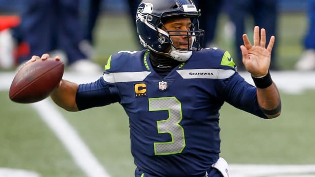 Seattle Seahawks quarterback Russell Wilson (3) passes against the Los Angeles Rams during the first quarter at Lumen Field