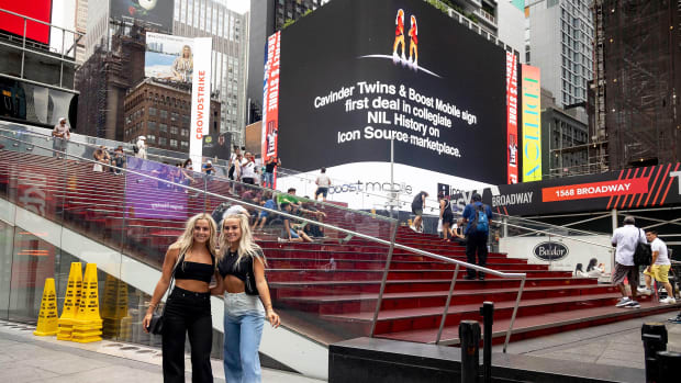 The Cavinder twins pose in Times Square