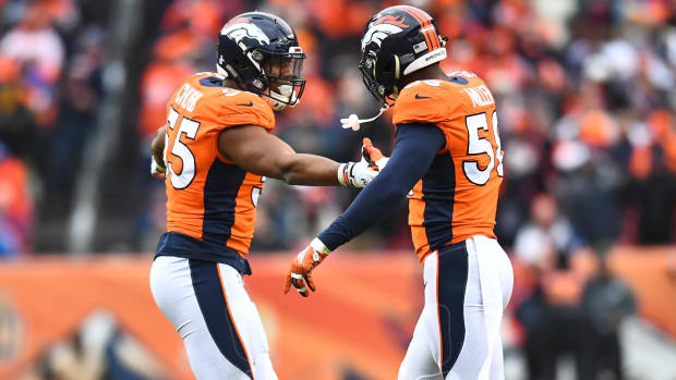 Denver Broncos linebacker Bradley Chubb (55) celebrates with linebacker Von Miller (58) after a sack against the Los Angeles Rams in the fourth quarter at Broncos Stadium at Mile High.