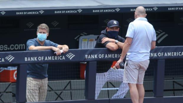 Yankees managing general partner Hal Steinbrenner with Brian Cashman, Aaron Boone