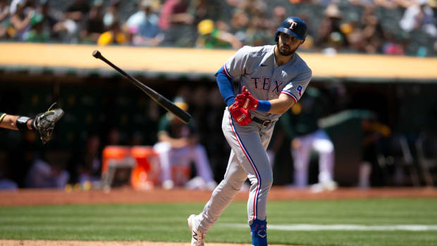 Jul 1, 2021; Oakland, California, USA; Texas Rangers right fielder Joey Gallo (13) tosses his bat after drawing a walk in the seventh inning against the Oakland Athletics at RingCentral Coliseum.