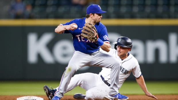 May 29, 2021; Seattle, Washington, USA; Texas Rangers second baseman Nick Solak (15) attempts to turn a double play against Seattle Mariners designated hitter Kyle Seager (15) during the sixth inning at T-Mobile Park.