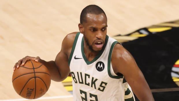 Milwaukee Bucks forward Khris Middleton (22) dribbles the ball