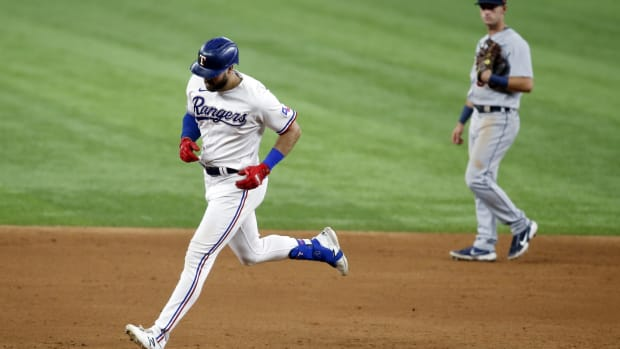 Jul 5, 2021; Arlington, Texas, USA; Texas Rangers right fielder Joey Gallo (13) rounds the bases after hitting a two run home run in the ninth inning against the Detroit Tigers at Globe Life Field.