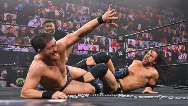 Adam Cole and Kyle O'Reilly tied up in a leg lock
